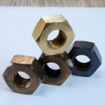 4 patinated nuts in different colours